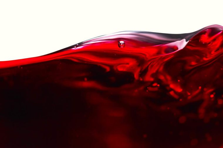 Red wine isolated on white background , abstract splashing , saved clipping path.