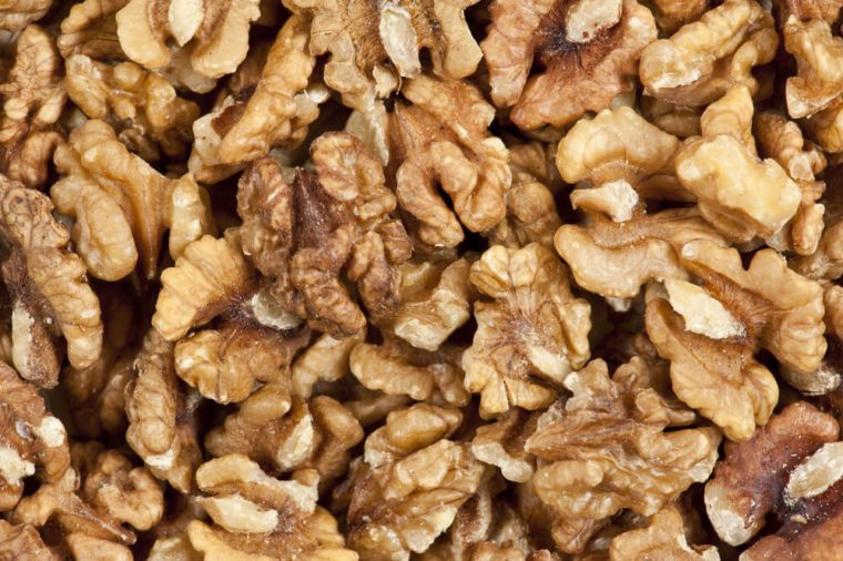 Heap of unshelled walnuts, seen from directly above and in full frame