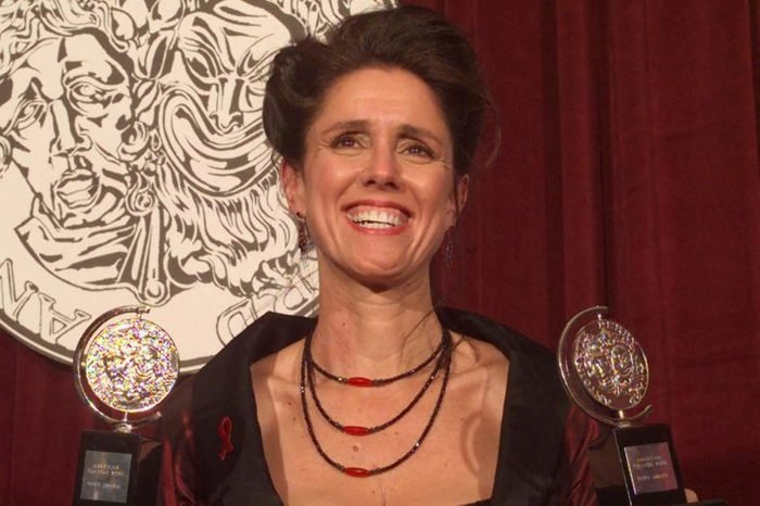 """TAYMOR Julie Taymor holds her two Tony Awards backstage at New York's Radio City Music Hall . Taymor, the driving force behind """"The Lion King,"""" won for Best Direction of a Play and for Best Costume Design"""