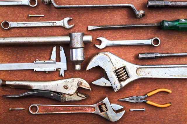 Working tools on wooden table background. top view