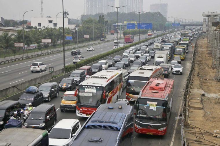 Vehicles are caught in a congestion as the flow of traffic of the capital significantly increases ahead of Eid al-Fitr holiday in Jakarta, Indonesia, . The mass exodus out of Jakarta and other major cities in the world's most populous Muslim country is underway as millions are heading home to their villages to celebrate Eid al-Fitr holiday that marks the end of the holy fasting month of Ramadan on June 25