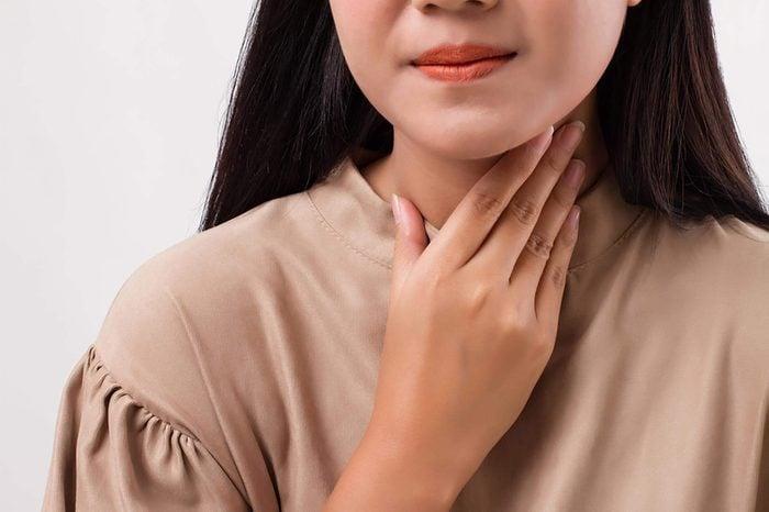 sick woman with sore throatsick woman with sore throat