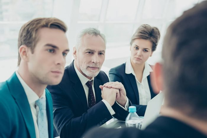 Portrait of concentrated business people having meeting in office