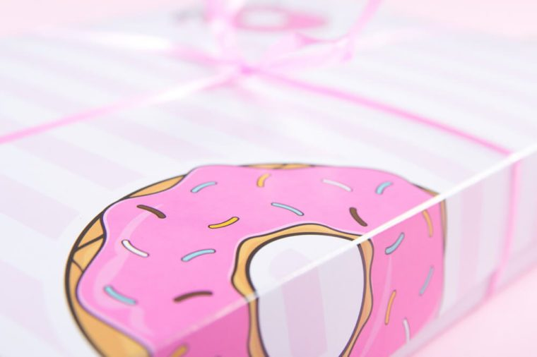 Closeup pink bakery box for donuts