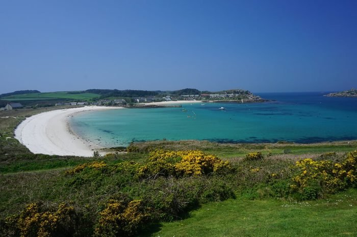 A sandy beach and clear sea water at the holiday island of Tresco, Isles of Scilly