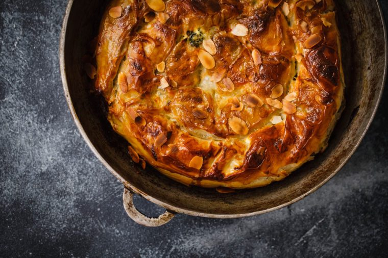 Greek style filo pastry pie round overhead comfort food