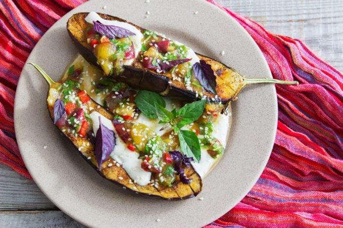 Baked eggplants plum salsa greek yogurt tahini sauce.