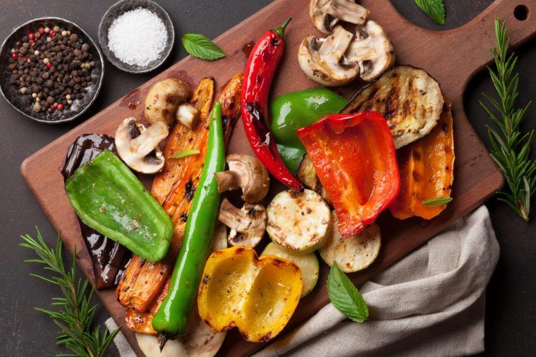 Greek foods you need to know at a greek restaurant readers digest grilled vegetables on cutting board on dark stone table top view forumfinder Gallery