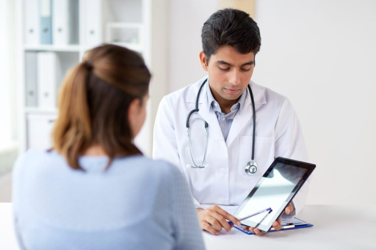 medicine, healthcare and technology concept - doctor showing tablet pc computer to patient at hospital
