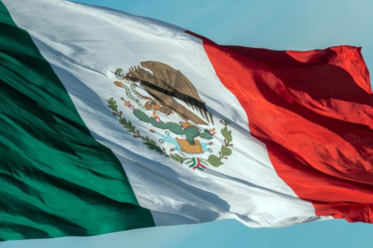 Mexican flag weaving on sky background