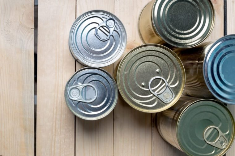 Tin cans for food on wooden background