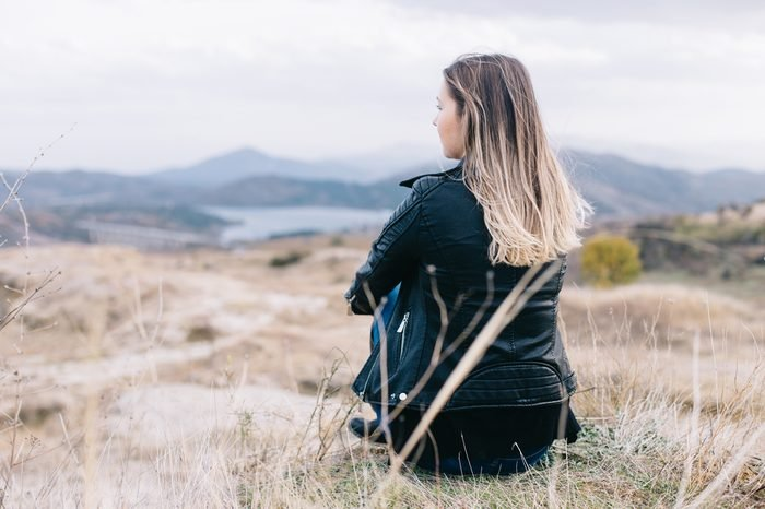 Woman enjoying the view of the beautiful landscape