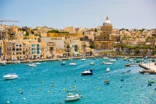 many little yachts and boats from plan wiev to the bay near Valletta in Malta