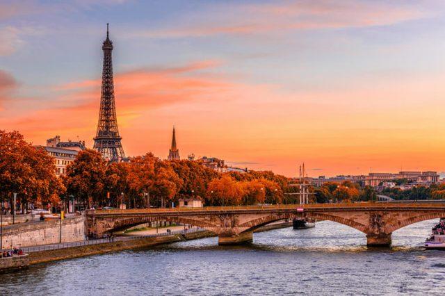 Sunset view of Eiffel tower and Seine river in Paris, France. Autumn Paris. Architecture and landmarks of Paris. Postcard of Paris