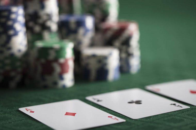 Poker gamer. Poker chips on green canvas.