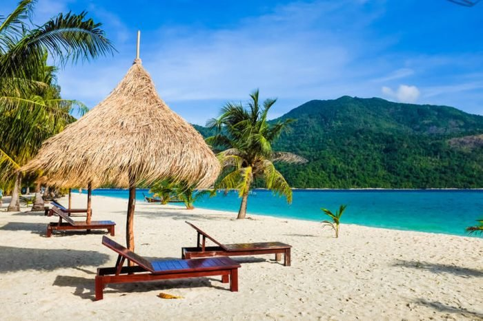 This is the vacation time show wood chairs on a beautiful tropical beach with white sand and clear turquoise ocean at exotic island