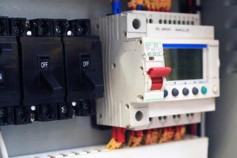 Circuit breakers red switch installed in the steel main distribution board and breaker turn off.