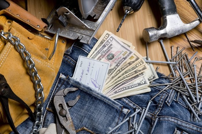 Construction tool with dollars. Hammer drill saw and all instrument