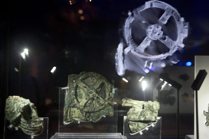 Fragments of the 2,100-year-old Antikythera Mechanism, believed to be the earliest surviving mechanical computing device, is displayed at the National Archaeological Museum, in Athens, Thursday, June 9, 2016. An international team of scientists says a decade's painstaking work on the corroded fragments found in an ancient Greek shipwreck has deciphered roughly 500 words of text that explained the workings of the complex machine, described as the world;s first mechanical computer
