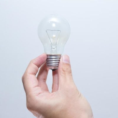 Hand hold Lightbulb Creativity or Thinking Innovation Creative concept
