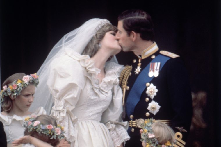 On the balcony of Buckingham Palace Prince Charles and Princess Diana kiss on their wedding day