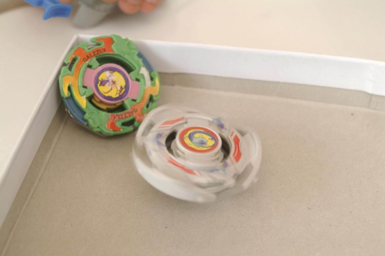 MODEL RELEASED Boys plays with beyblade