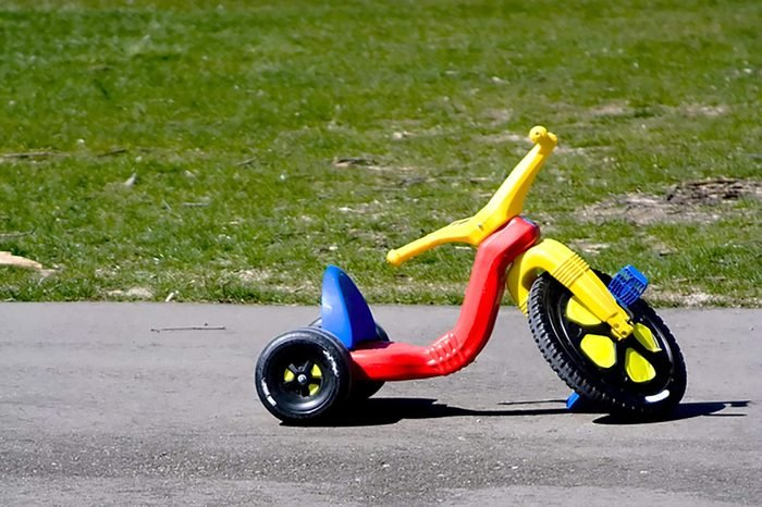 Childhood red and yellow plastic tricycle big front wheel
