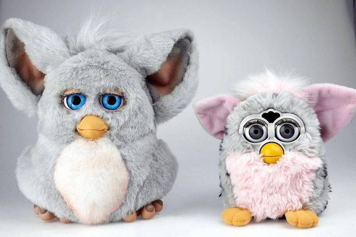 The new version of the Furby interactive toy (L) with the old one. It can smile, frown and communicate more than 30 different emotions