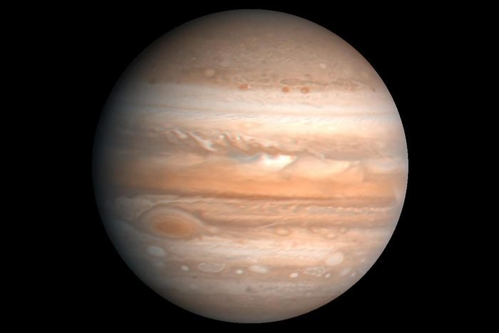 This processed color image of Jupiter was produced in 1990 by the U.S. Geological Survey from a Voyager image captured in 1979. Zones of light-colored, ascending clouds alternate with bands of dark, descending clouds.
