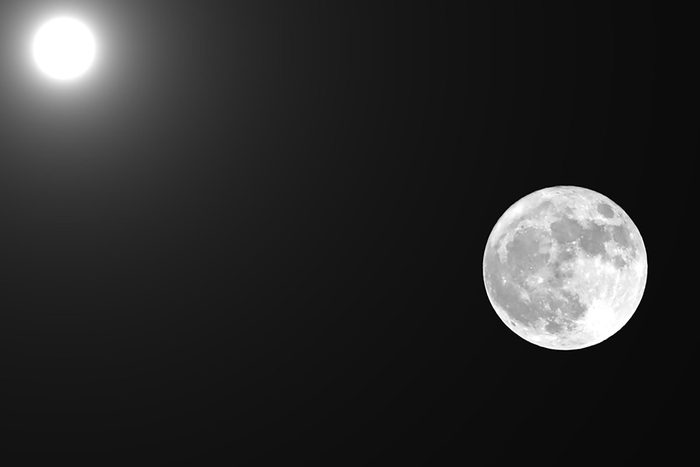 full moon and the sun in the same photographic frame