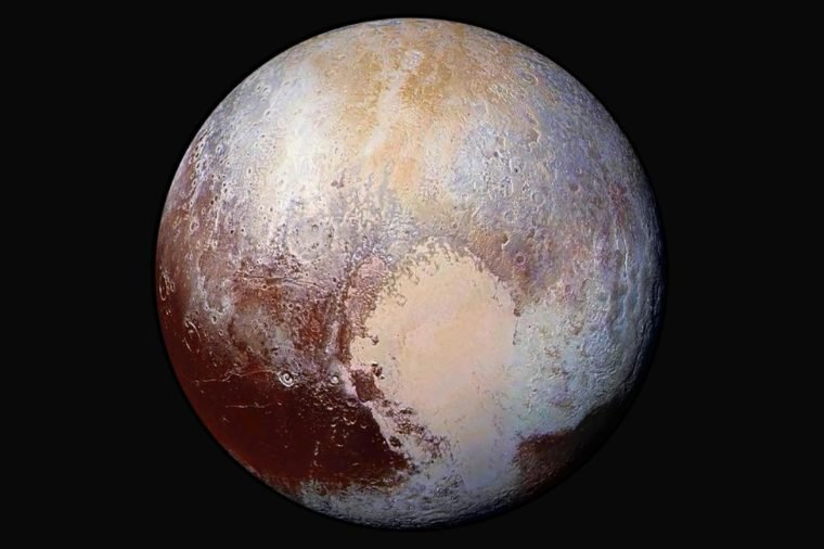 Four images from New Horizons Long Range Reconnaissance Imager LORRI were combined with color data from the spacecraft Ralph instrument to create this enhanced color global view of Pluto.