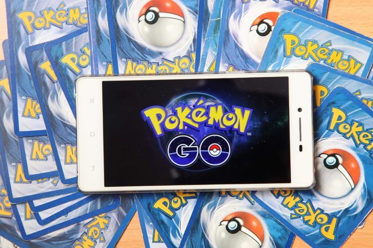 Kuala Lumpur,Malaysia 23th July 2016, smartphone with pokemon go logo on the screen on top of pokemon card