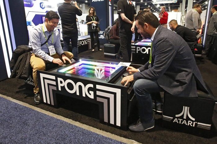 People play Pong the Atari game on opening day at the 2018 International Consumer Electronics Show in Las Vegas, Nevada, USA, 09 January 2018. The annual CES which takes place from 9-12 January is a place where industry manufacturers, advertisers and tech-minded consumers converge to get a taste of new innovations coming to the market each year.