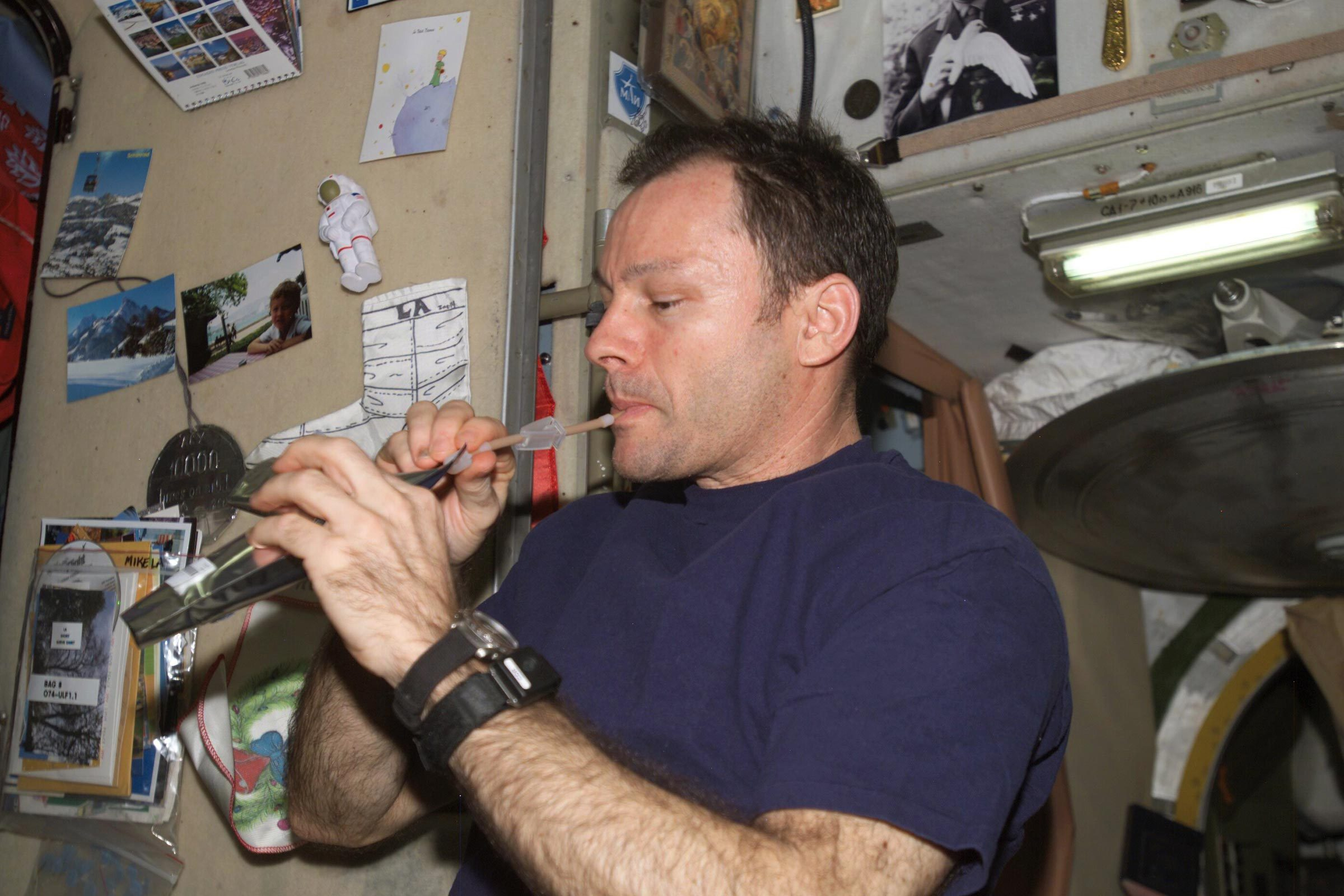 Astronaut Michael E. Lopez-Alegria, Expedition 14 commander and NASA space station science officer, drinks a beverage in the Zvezda Service Module of the International Space Station.