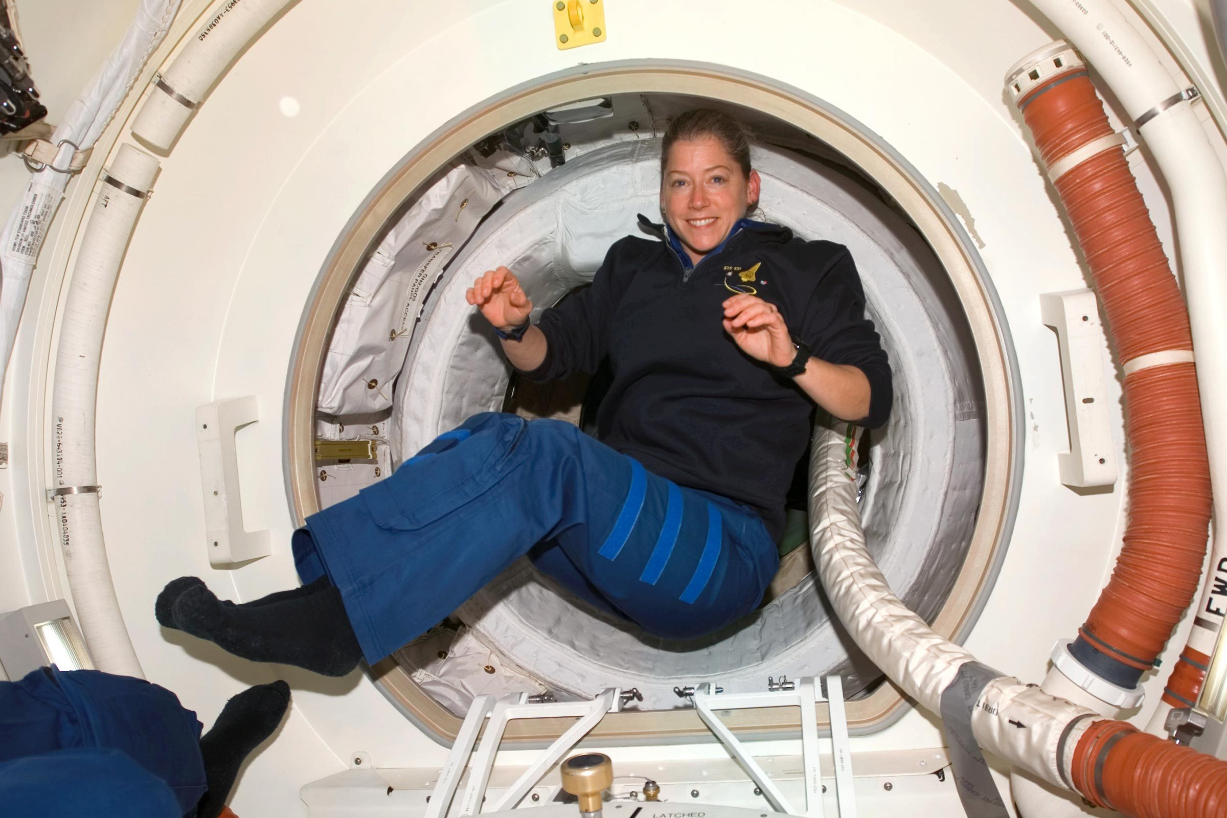 Astronaut Pam Melroy, STS-120 commander, floats in the Orbiter Docking Compartment (ODS) after hatch opening between the International Space Station and Space Shuttle Discovery.