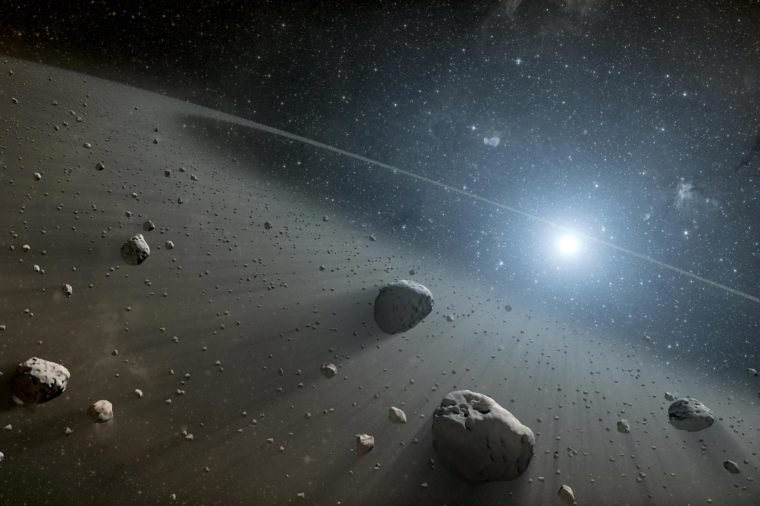 This artist concept illustrates an asteroid belt around the bright star Vega. Evidence for this warm ring of debris was found using NASA Spitzer Space Telescope, and the European Space Agency Herschel Space Observatory.