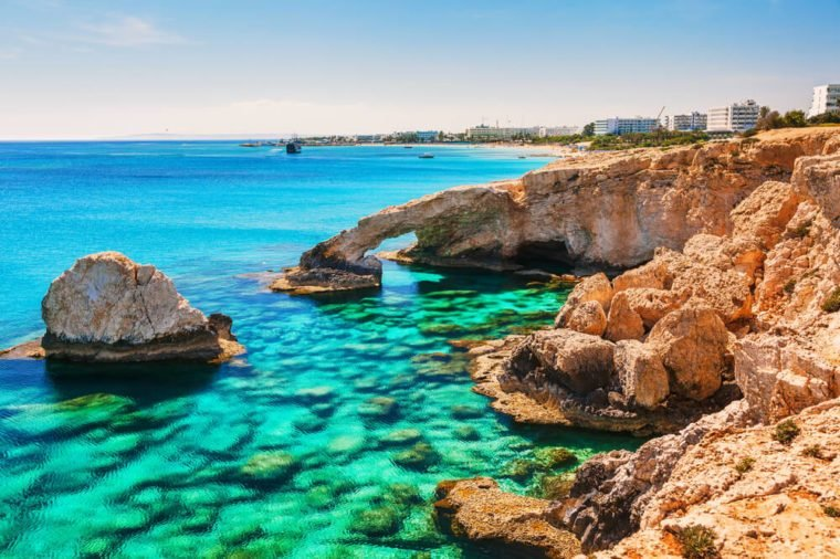 Beautiful natural rock arch near of Ayia Napa, Cavo Greco and Protaras on Cyprus island, Mediterranean Sea. Legendary bridge lovers. Amazing blue green sea and sunny day.