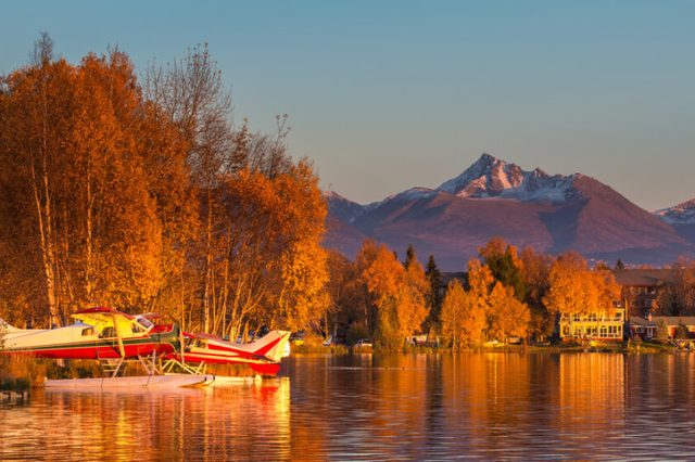 Warm colors of sunset at Spenard Lake in Anchorage. USA.