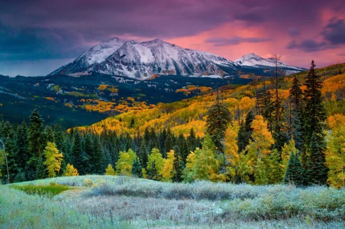 Fall rushes in to Colorado in the form of snow and frost at sunrise along Kebler Pass in Crested Butte as East Beckwith Mountain is covered in a fresh dusting.