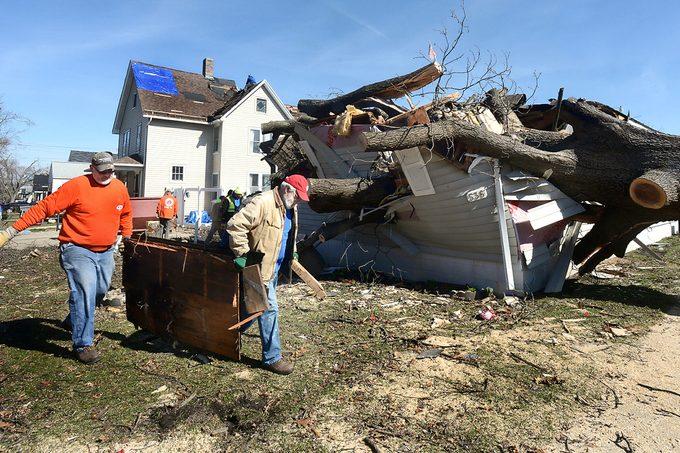volunteers clean up after tornado