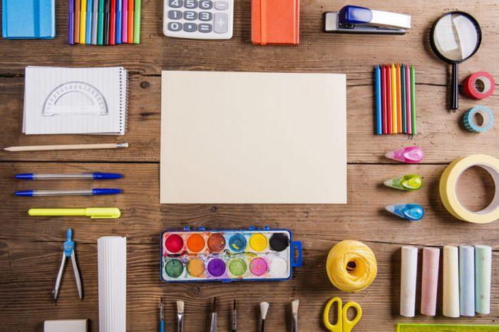 Desk with stationary. Studio shot on wooden background. Ã??