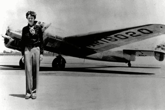 EARHART Amelia Earhart, 40, stands next to a Lockheed Electra 10E, before her last flight in 1937 from Oakland, Calif., bound for Honolulu on the first leg of her record-setting attempt to circumnavigate the world westward along the Equator