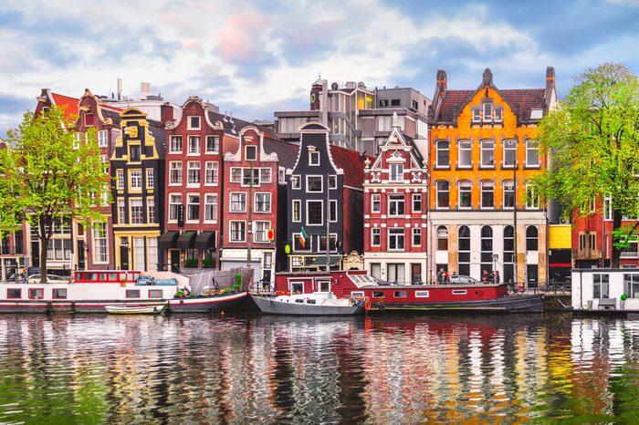 Amsterdam Netherlands dancing houses over river Amstel landmark in old european city spring landscape.