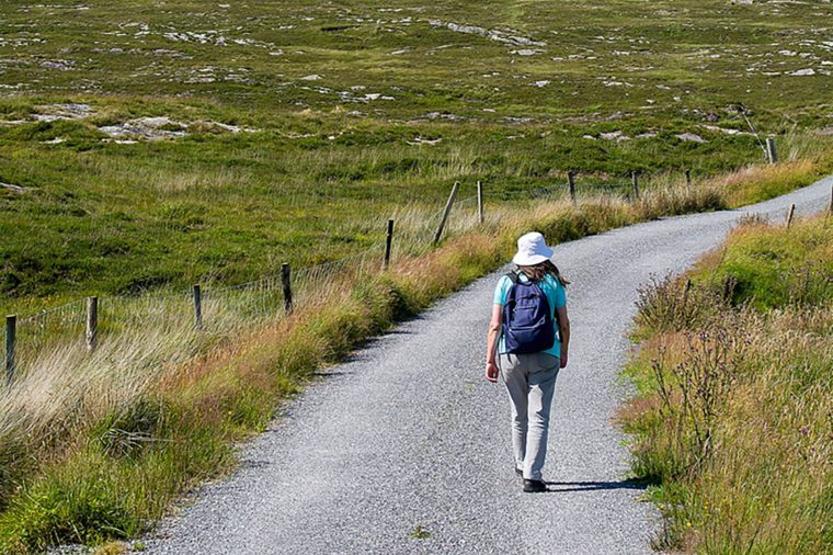 Bantry,Ireland - July 12, 2017: Hiker on Country Lanes in County Cork, Ireland