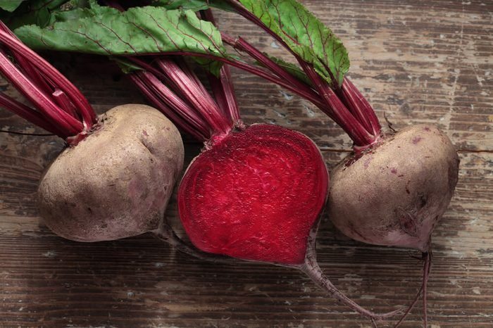 Beetroot with herbage on wooden background