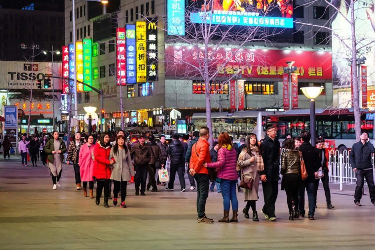 Beijing, China - 5 March 2016 : Unidentified people enjoy walking and sightseeing at Wangfujing Street. Wangfujing Street is one of the most famous shopping streets in China as a paradise for shoppers