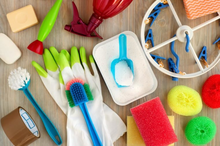 Household utensils for hygiene and cleanliness. Washing powder, clothespins, rubber gloves, brushes are household items. View from above. House utensils of different kinds. Hygiene products for home.