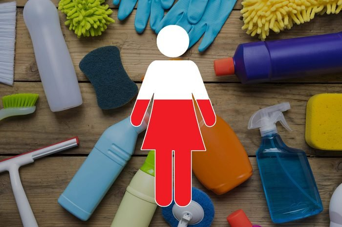 cleaning supplies on wood background with female symbol overlay