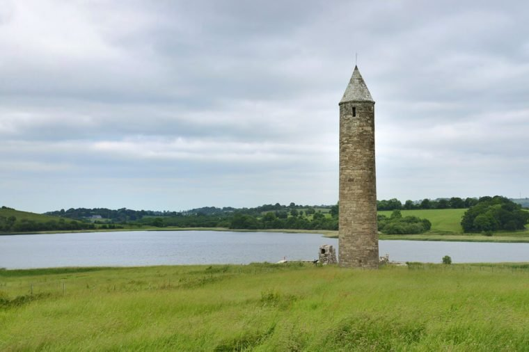 A twelfth century tower on Devenish Island which was part of a monastery. Near Enniskillen in Northern Ireland, the island is one of many on Lough Erne and is visited daily by hundreds of tourists