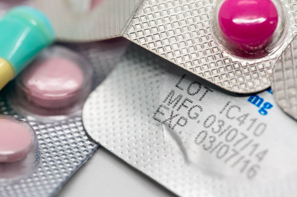 Packaging of Expired pills and tablets on white background, Medicines.